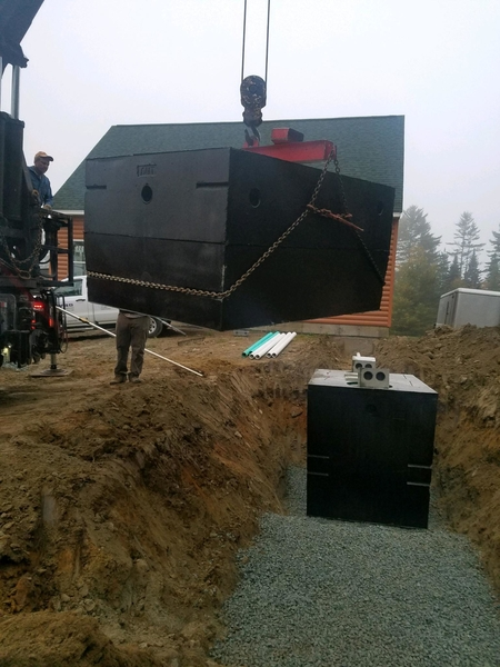 Septic tank being placed
